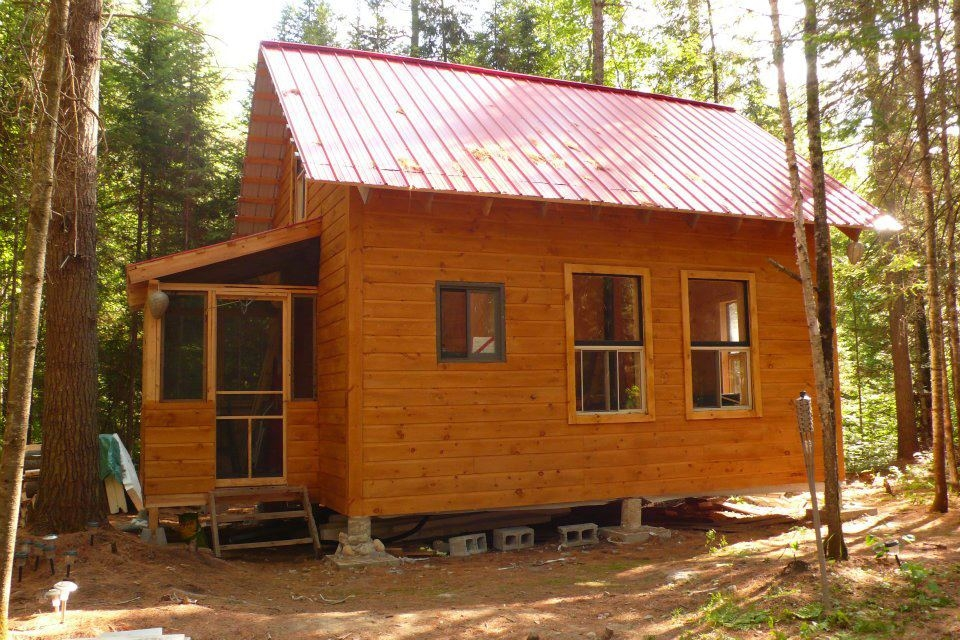 small cabin in the woods living the simple life off the grid Cost To Build A Small Cabin